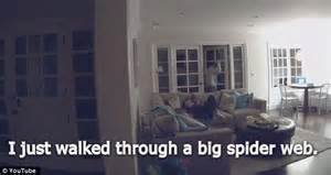 an entire family freak out a spider in the