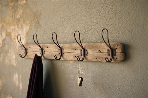 rustic wood coat rack with vintage wire hooks