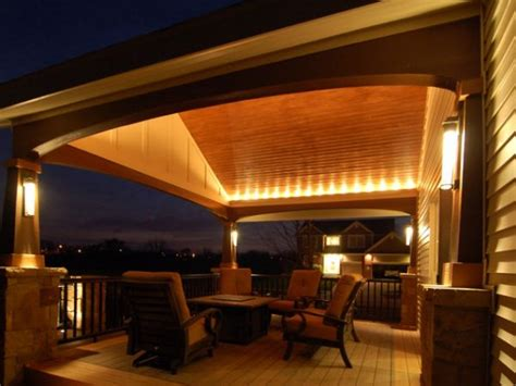 mood lighting ideas covered patio with fireplace outdoor
