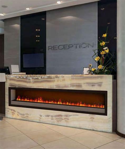 Dimplex Optimyst electric fireplace set into onyx