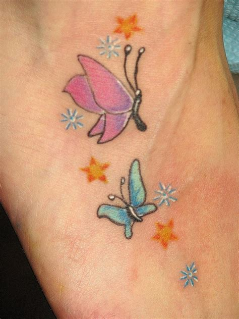 small pink tattoos blue and pink small butterfly with