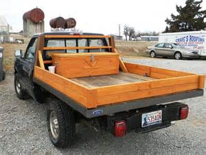 custom built all wooden truck bed made from recycled