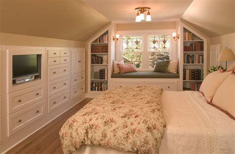 traditional guest bedroom with built in bookshelf by chris