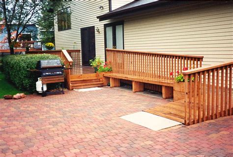 ramp  located    entrance   home  bench  constructed   side
