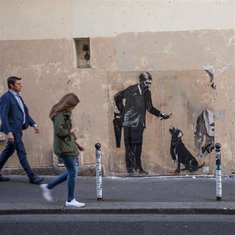 planet banksy the man 1782431586 new banksy street art appears across paris taking aim at