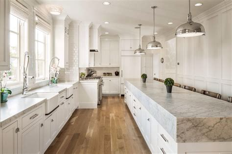 miami shaker cabinets white kitchen transitional with copper accents trim and border tiles white marble waterfall island with copper pendant