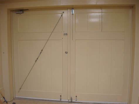 swinging door exchange what style of lock for swinging garage doors that shift