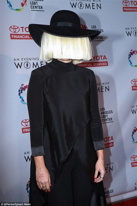 singer of chandelier sia hides features wig to perform