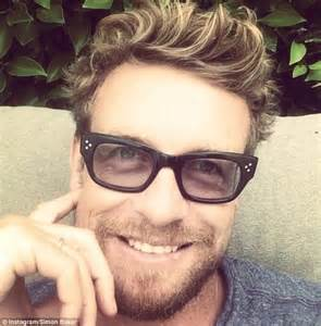 actor with thick rimmed glasses simon baker suits up for japan cup and fulfills duties as