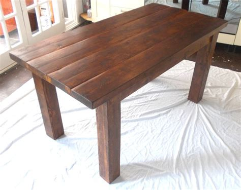 rustic solid wood plank kitchen dining table stained in