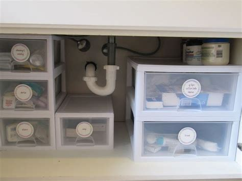 under bathroom sink organization ideas utilize the space under the bathroom sink with small