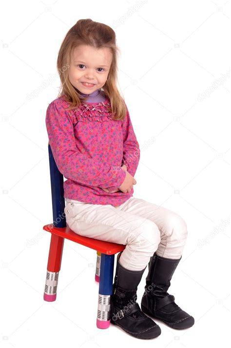 little girl on chair little girl sitting in a chair stock photo 169 verkoka
