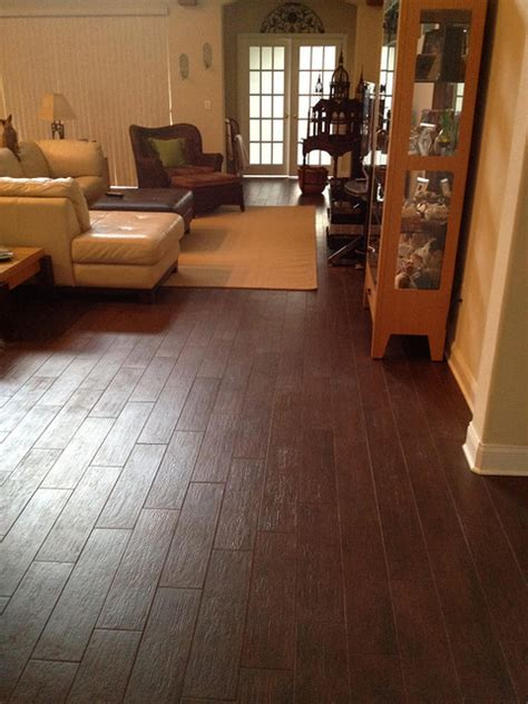 Tile Floors In Living Room by Porcelain Plank Wood Look Tile Installations Ta