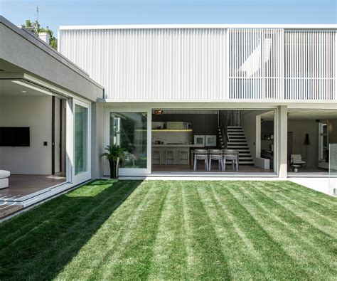 Sloping Lot A Concrete Box On The Back Of A Villa Manages To Both