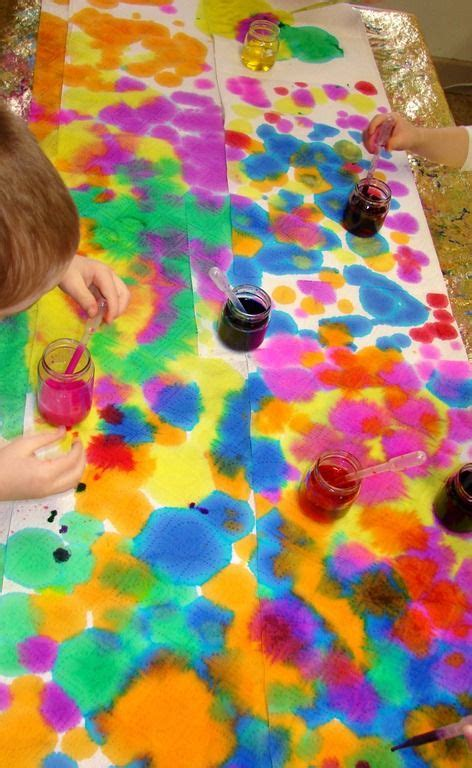 color dropper using droppers with food colouring onto paper towel