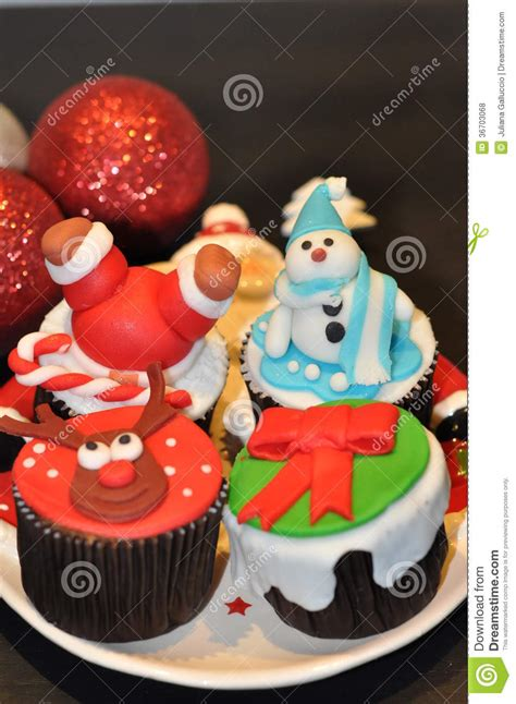 cupcakes with christmas decorations royalty free stock
