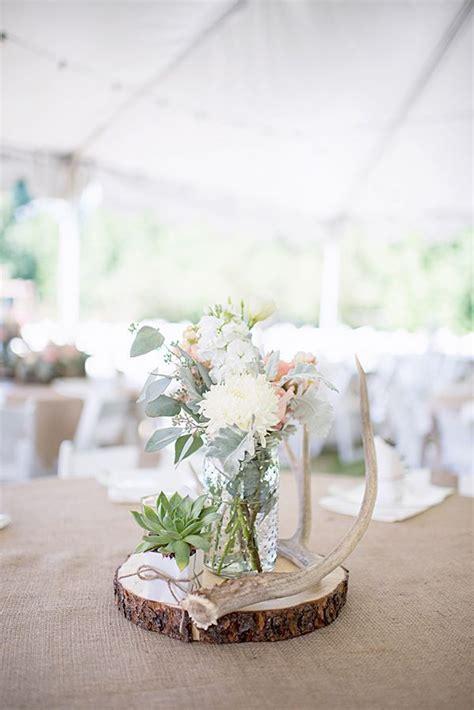 rustic wedding decor mason jars and deer antlers