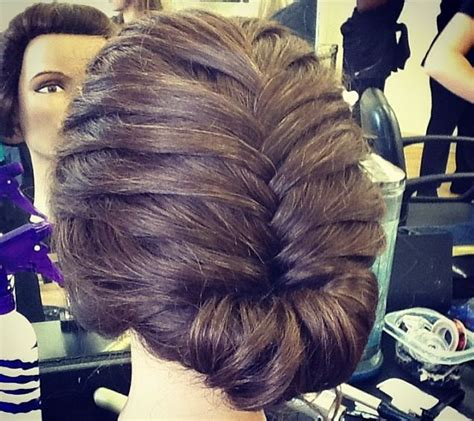 updo secret extensions elegant french braid updo created by one of our
