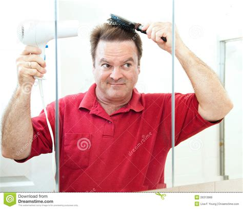 Kitchen Designers Plus mature man drying his hair royalty free stock images