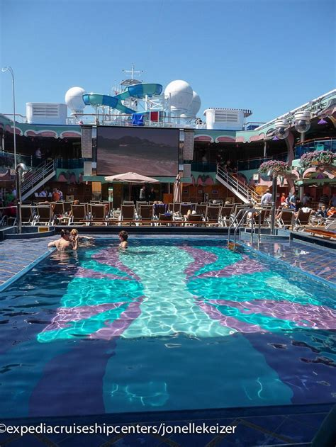 carnival cruises the main pool on the carnival splendor