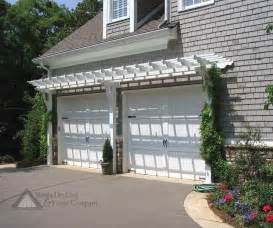 Charming arbor enhances cape cod garage from atlanta decking and