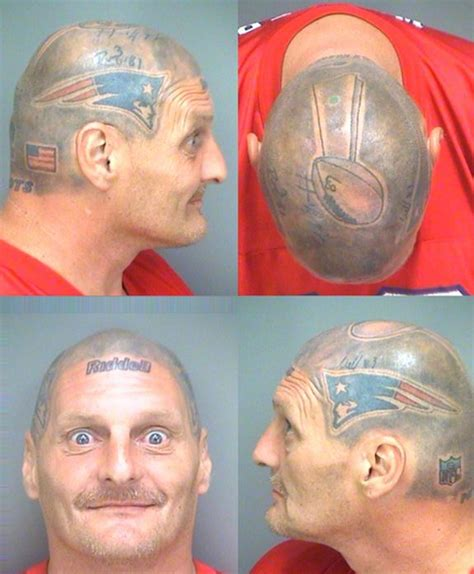 guy with patriots helmet tattooed on head has the best mug