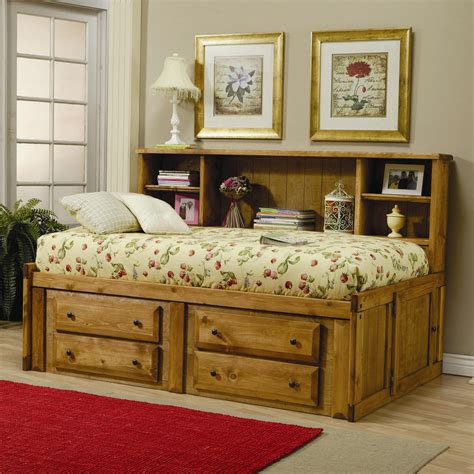 rustic bed frame with storage and bookcase on the