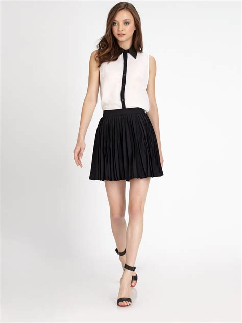 olette pleated mini skirt in black lyst