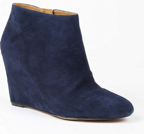 nine west riguma wedge ankle boots in blue lyst