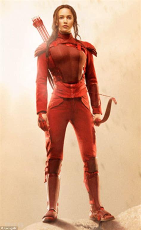 the hunger games katniss everdeens mockingjay suit 5 dramatic new hunger games mockingjay poster shows tough