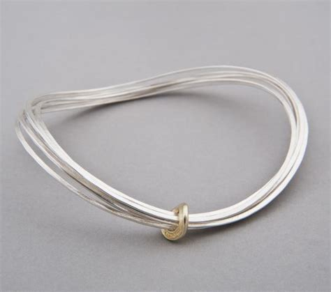 Handcrafted Bangles - silver curved ripple bangle handmade equinox jewellery