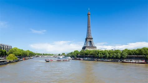 boat trip near eiffel tower river seine with the eiffel tower in the distance circa