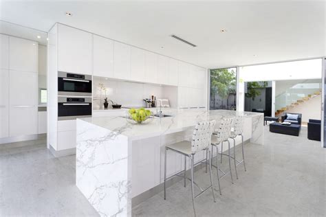 White Kitchen Cabinets Ideas For Countertops And Backsplash quartz island kitchen transitional with waterfall