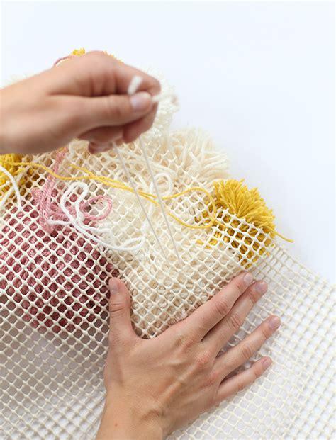 diy pom pom rug how to make an awesome diy pom pom rug