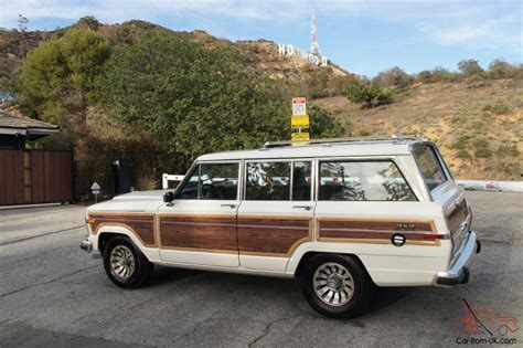 jeep wagoneer white 1986 jeep grand wagoneer w wood paneling white tan