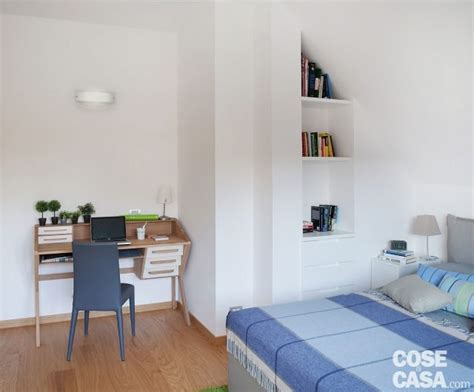 da letto con libreria cucina a vista sul soggiorno nel sottotetto con terrazzi a