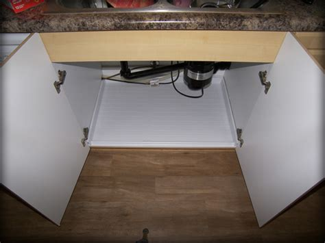 kitchen cabinet protector driptite slide n fit under sink pan cabinet base