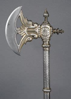 inside the sword cold by axe with carved decoration and gold inlay