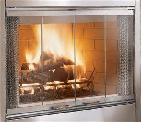glass doors for wood burning fireplace monessen stainless steel bi fold glass fireplace door kit