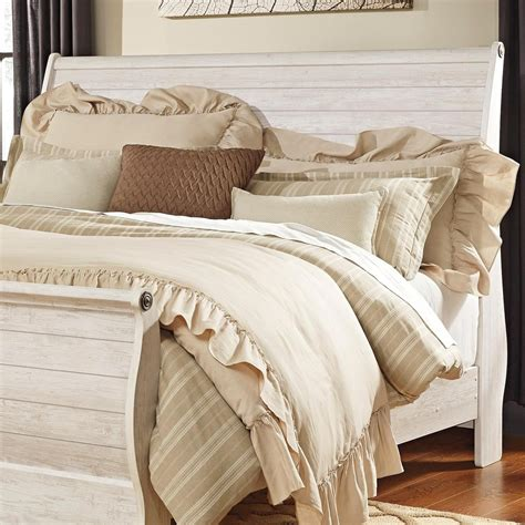 king sleigh headboard in washed rustic finish by signature