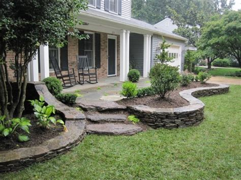 this landscaping design extends past the front porch and around both ends of the house front