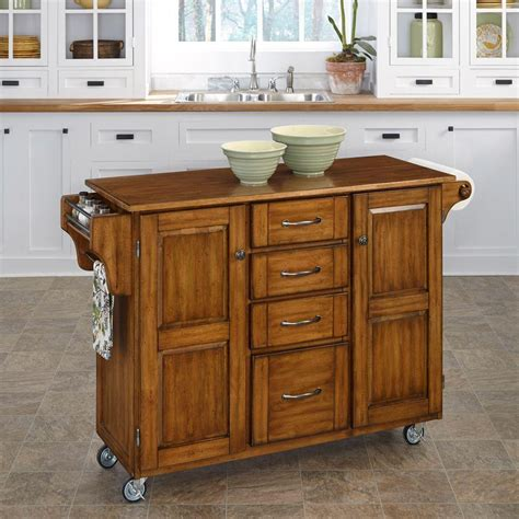 home styles create a cart warm oak kitchen cart with towel bar 9100 1066g the home depot