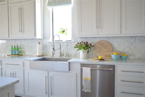 carrara marble backsplash herringbone backsplash tile free kitchen with white