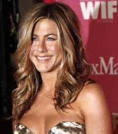 Balayage hair color gives sparkling finishing to curly long and