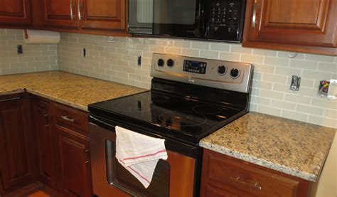 How To Install A Glass Tile Backsplash In The Kitchen how to install a glass tile kitchen backsplash parts 1 amp 2