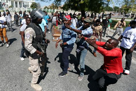 haiti police fire rubber pellets  mourners  protests