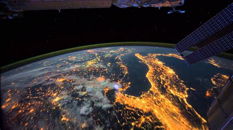 look at lights all alone in the time lapse footage of the earth