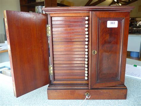 Coin Cabinet tennants auctioneers turton mahogany coin cabinet