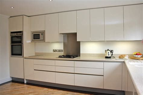 Open Plan Galley Kitchen - high gloss cream acrylic kitchens