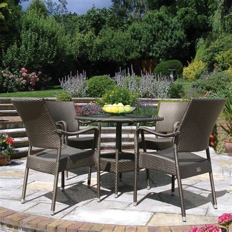 round dining table with armchairs 90cm windsor round dining table with 4 stacking armchairs bronze bridgman